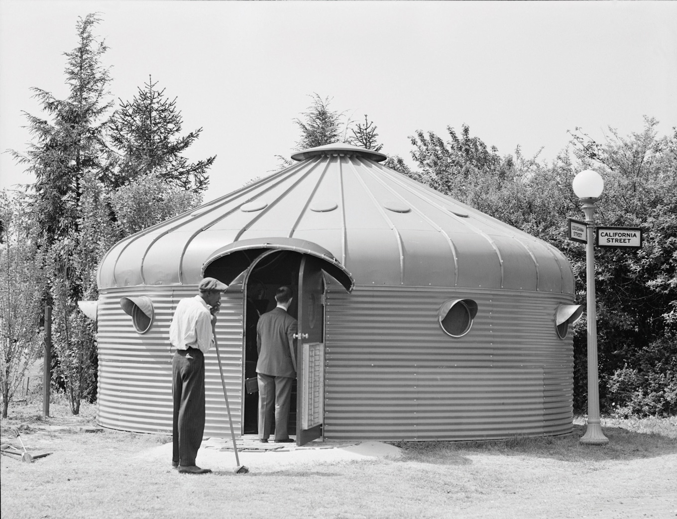 Dymaxion House metal bunker with two men