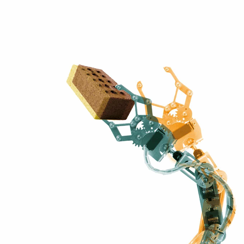 Robot arm holding a brick