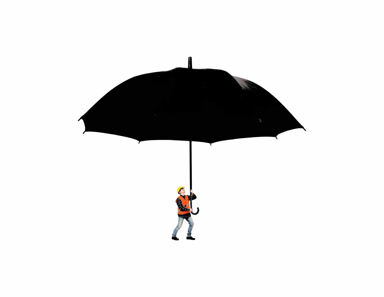 Constructor holding a big black umbrella