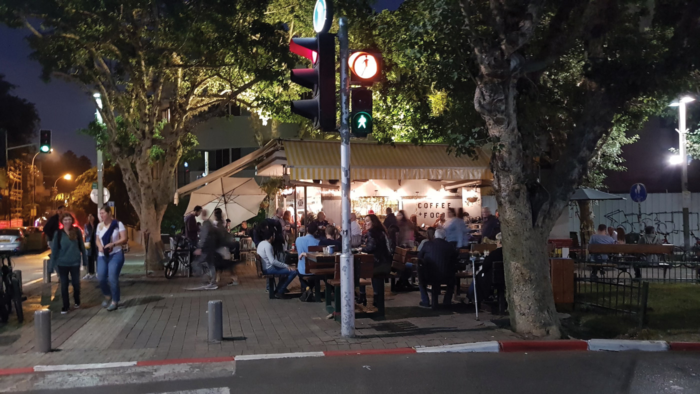 Photo of a street in Tel Aviv at night