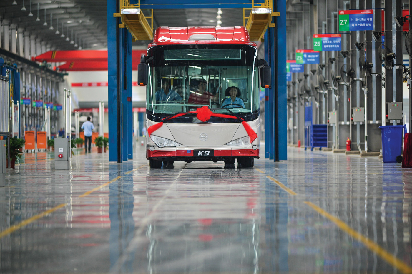 picture of an electric bus in a garage