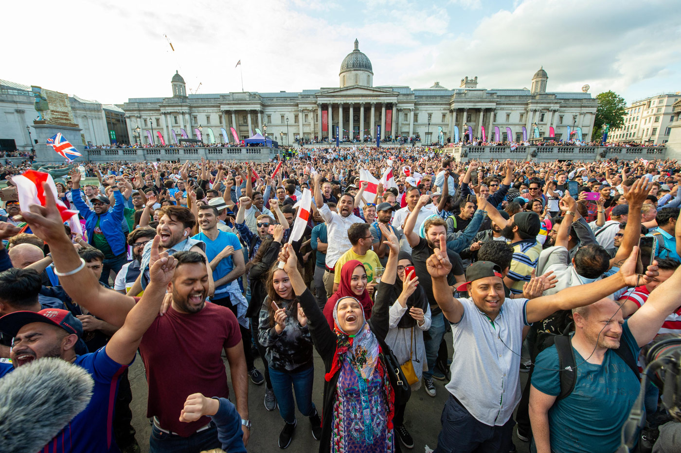 Cricket fans watching the 2019 World Cup final in Trafalgar Square, London